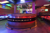 Bar in a modern nightclub with colorful lights — Стоковое фото