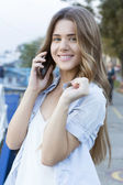 Cute young woman talking on the phone outdoors — Foto Stock