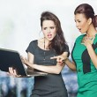 Two businesswomen looking at computer screen shocked — Stock Photo #58580993