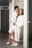 Couple in bathrobes at spa center — Stock Photo