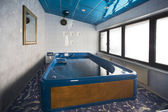 Big hydrotherapy tub in spa center — Stock Photo