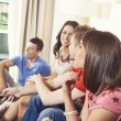 Friends at home watching TV and having fun — Stock Photo #59428387