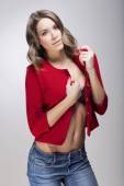Beautiful young woman in bra and red jacket — Stock Photo