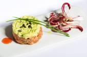 Salmon and avocado tartare with chicory — Stock Photo