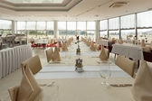Bright restaurant interior with tables arranged for special even — Stock Photo