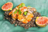 Shrimps served with black quinoa and fig — Stock Photo