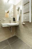 Hotel bathroom sink and mirror — Stock Photo