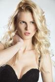 Portrait of a blonde woman in black bra — Stock Photo