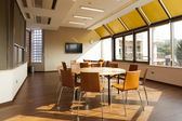 Meeting room with round tables — Stock Photo
