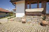 Old tavern exterior with cobblestone path — Stock Photo