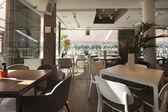 Interior of an elegant riverside cafe — Stock Photo