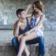 Young woman sitting in boyfriend's lap — Stock Photo #77451338