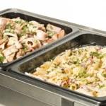 Hot food table with pasta and calamari — Stock Photo #77623446