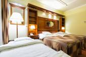 Elegant hotel twin bedroom with an extra bed — Stock Photo