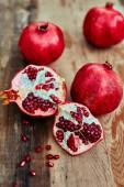 Pomegranates on a dark wooden background — Foto de Stock