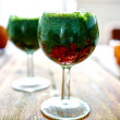 Green vegetable juice in wine glass — Stock Photo #77486478