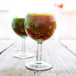 Green vegetable juice in wine glass — Stock Photo #78337722
