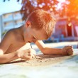 Boy with sketch pen drawing — Stock Photo #78901326