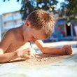 Boy with sketch pen drawing — Stock Photo #78903716