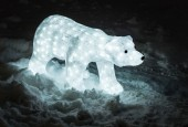 Decoration bear in lights with snow — Stock Photo