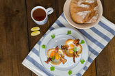 Muffins with eggs and bacon — Stock Photo