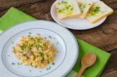 Scrambled eggs with chive and bacon, toast with herbs — Stock Photo