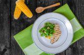 Chicken steak with garlic and lemon, salad — Stock Photo