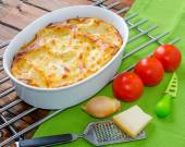 Lasagne bolognese in a baking dish — Stock Photo