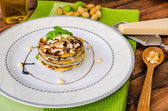 Grilled eggplant with feta cheese,parmesan basil, nuts — Stock Photo