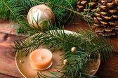 Christmas candle with pine needles — Stock Photo