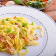 Italian pasta with spring onion and bacon — Stock Photo #54061995