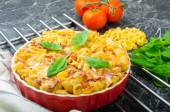 Baked homemade pasta with leeks, bacon and cream — Stock Photo