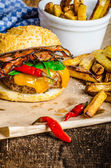 Homemade chilli burger with home spicy fries — Stock Photo
