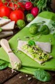 Home avocado spread on Crispbread with seeds — Stock Photo