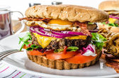 Beef burger, red onion and fried egg — Stock Photo