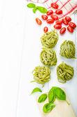 Pasta background - spinach tagliatelle — Stock Photo