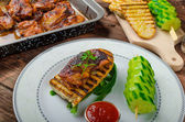 Sticky chicken with spicy sauce, toasted panini — Stock Photo