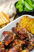 Sticky chicken wings with garlic panini bread — Stock Photo