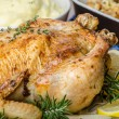 Feasting - stuffed roast chicken with herbs — Stock Photo #59916551