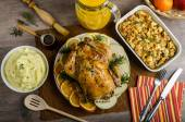 Feasting - stuffed roast chicken with herbs — Stock Photo