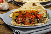 Indian naan with meatballs and tomato sauce — Stock Photo