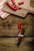 Chilli peppers, wood table, background — Stock Photo