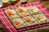 Bio healthy food - kneckebrot spread cheese with smoked salmon and cherry tomatoes — Stock Photo