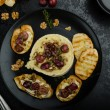 Brie cheese baked with nuts and grapes — Stock Photo #63339255