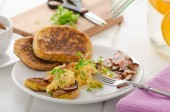 Scrambled eggs with French toast topped with watercress Scrambled eggs with watercress, french toast — Stock Photo