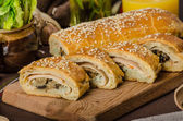 Roll out puff pastry stuffed — Stock Photo