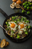 Vegetable omelet with bulls eye egg and sprouts — Stock Photo