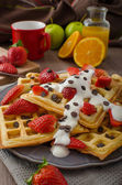 Homemade waffles with maple syrup and strawberries — Stock Photo