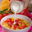 Healthy breakfast cornflakes with milk and fruits — Stock Photo #67549945