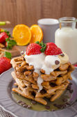 Belgian waffles with chocolate chips and fruits — Stock Photo